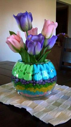 Easter Decor - Colored jelly beans, Peeps and beautiful spring tulips - So Pretty ! Easter Flower Arrangements, Easter Flowers, Easter Centerpiece, Easter Decor, Easter Ideas, Fake Flowers, Centerpiece Ideas, Easter Recipes, Peeps Recipes