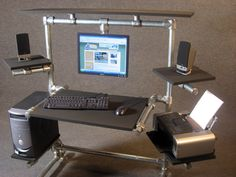 DIY Desk featured on Ron Hazelton's HouseCalls - love the hanging monitor!
