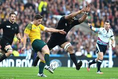 New Zealand flanker Jerome Kaino steams in to try and block a kick by Australian fly half Bernard Foley in the first half