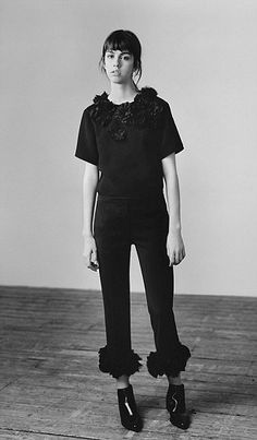A dark top and trousers with ruffle detail