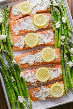 One-Pan Salmon Asparagus recipe with a lemon-garlic-herb butter. Every bite is so juicy and flavorful! A reader favorite, salmon dinner. Baked Salmon And Asparagus, Lemon Garlic Salmon, Baked Salmon Recipes, Asparagus Recipe, Recipes With Asparagus, Seafood Dishes, Seafood Recipes, Butter Salmon, Salmon Dinner