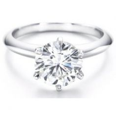 "Propose to her with a white gold engagement diamond ring and she is sure to say ""yes."" A white gold solitaire diamond engagement ring is a timeless..."