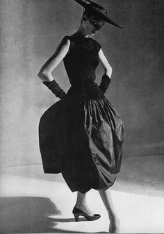 This is a 1952 Balenciaga evening gown. Balenzciaga had a Fashion house in Spain and was admired by many designers such as Coco Chanel and Christian Dior.