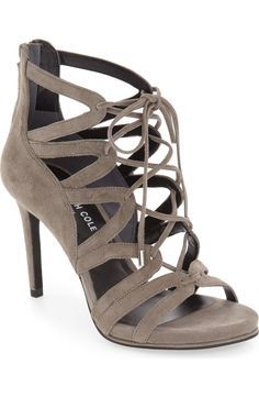 Sleek suede straps define this lofty open-toe sandal that's ready to step out on the town.