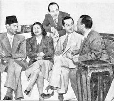 Egyptian diva Um Kalthoum with prominent singer-composer Farid Al-Atrash, of Syrian origin, with a host of musicians and poets