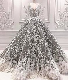 This dark grey ball gown could be used as a #wedding dress.  The ornate embellishment ad to the #fashion #style & design.  We are in the #USA and specialize in making #custom #dresses and #ballgowns for #women all over the globe.  Our firm also provides inexpensive #replications of #hautecouture #gowns.  So if the #original is way over your budget we can make a version that has the same look for less. Email us for pricing and more details on custom #womensfashion for your next special…