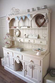 I love this painted. Mine is almost like this, but without doors at the bottom and it is still unpainted pine.