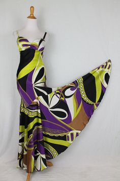 Cache Green, Purple, Black, White Vintage Pucci Print Silk Bias Cut Mermaid Hem Gown Dress. Free shipping and guaranteed authenticity on Cache Green, Purple, Black, White Vintage Pucci Print Silk Bias Cut Mermaid Hem Gown DressVintage Cache Printed Silk Mermaid Hem Evening Gow...