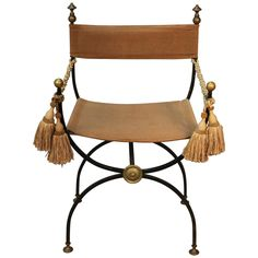950 Savonarola Chair, Iron with Brass Finials | From a unique collection of antique and modern armchairs at https://www.1stdibs.com/furniture/seating/armchairs/