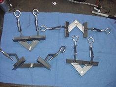 Tubing Clamp by INSAYN -- Homemade tubing clamps intended to aid in chassis fabrication. Fabricated from scrap steel, bolts, and nuts. http://www.homemadetools.net/homemade-tubing-clamp