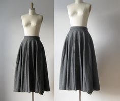 """via Dronning Vintage  vintage 1980s midi skirt  medium charcoal gray  sits at waist and flares out  centered box pleats at waist  two hidden hip pockets  back center zipper and   button closure  material is a wool/poly  blend, feels and looks   like lightweight wool  skirt is very, very full,  almost a circle skirt but not quite    measurements....    waist: 26""""  hip: free sweep  length: 31""""  brand/maker: Esprit  condition: excellent"""