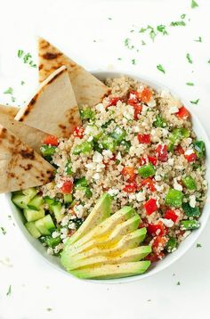Loaded with fresh veggies and drizzled in a light homemade dressing, these tasty vegetarian Greek Quinoa Bowls make healthy eating a breeze!  Whenever I ask what recipes you'd like more of, healthy ve