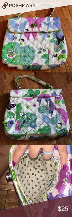 Vera Bradley Nicole Butterfly Garden Handbag Limited edition sateen collection has been retired. This handbag is in great condition. It's only flaw is that it is slightly discolored on the handle which I have shown both sides of in the photos. I did not try to clean it, so it could possibly come clean. The inside is clean and there are no stains that I saw. The bag has two slip pocket and one zipper pocket on the inside. It is 11x9 inches. Smoke free, pet friendly home. Vera Bradley Bags