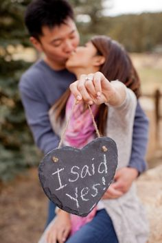 engagement pictures @Traci Puk Puk Smith found a use for those shaped chalk boards we saw at michaels