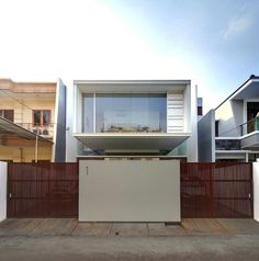 inspiring Marvelous Design Exterior Of Satu House By Chrystalline Facade View Applied Wood Gate Door And Conventional Wall Fence ,   #applied #by #chrystalline #conventional #Design #door #exterior #facade #fence #gate #house #marvelous #of #satu #view #wall #wood image from http://homesdesign.us/2014/07/22/marvelous-design-exterior-of-satu-house-by-chrystalline-facade-view-applied-wood-gate-door-and-conventional-wall-fence/