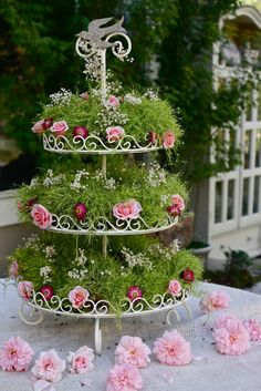 .greenery and few flowers on 3- tiered tray