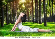 Yoga cobra pose in the park. Yoga bhujangasana cobra pose by woman in white cost , Inner Thigh Stretches, Tricep Stretch, Intense Cardio Workout, White Blood Cell Count, Neck Wrinkles, Cobra Pose, Flexibility Workout, Improve Flexibility, Circulation Sanguine