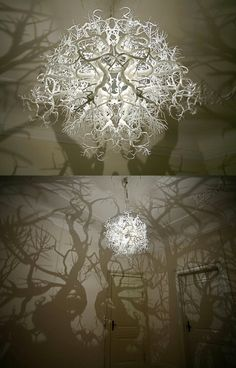 Chandelier from Hilden & Diaz projects a 360° shadow of trees.