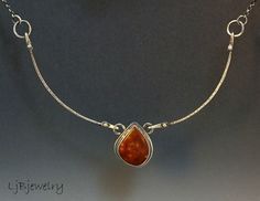 Sterling Silver necklace with a morgan hill poppy jasper cabochon