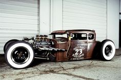 Scotty Chops' rat rod with a suicide shifter on the outside of the car.