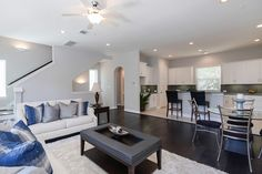 Living Room, dining and kitchen are all open concept. Wood floors in family and dining are a standard feature in a ROC home