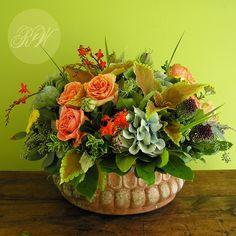 Handmade aged terra cotta pot filled with peach roses, hydrangeas, coleus, alliums, poppy seed heads and crocosmia...