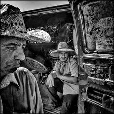 Matt Black.   USA. Tulare, California. 2014. Flea market vendors. Tulare has a population of 59,278 and 21.4% live below the poverty level.  Magnum Photos -
