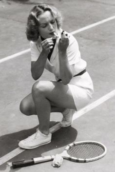 Carole Lombard taking a break on the tennis courts, Hollywood, 1937