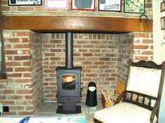 Charnwood Cove 1 multi fuel stove fitted into a refurbished Essex inglenook in Rochford, Essex by Scarlett Fireplaces in 2008