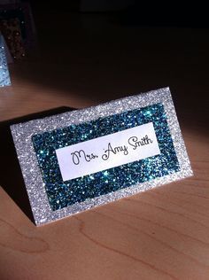 Glittered blue and silver place cards for birthdays by glamtastic, $1.50