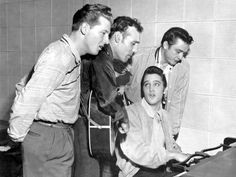"""Jerry Lee Lewis, Carl Perkins, Elvis Presley, Johnny Cash, ca. 1956. The """"Million Dollar Quartet"""" was really an impromptu jam (and publicity photo op, no doubt) between four famous musicians that was recorded by Sam Phillips at his Sun Studios."""