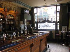 Window treatments, back bar, top shelf