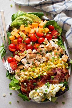 This is the most amazing cobb salad and it is so easy to make! It's loaded with your favorite toppings like egg, bacon, chicken, roasted corn, ripe tomatoes, cheese and avocado. Full recipe on lifemadesimplebakes.com #cobbsalad #salad #bacon #summer