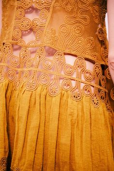 Yellow lace embroidery backstage at Chloé SS15 PFW. More images here: http://www.dazeddigital.com/fashion/article/21980/1/chloe-ss15