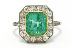The San Antonio Art Deco engagement ring. This enticing 3 carat Colombian emerald and diamond engagement ring, skillfully rendered in the Art Deco style features a large and lush gemstone. The octagon halo shimmering with 16 old European diamonds supported by a pierced filigree platinum and 18k yellow gold gallery. #artdeco #emerald #diamond #engagementring #love #ido #engaged #3caratemerald #3carat #3carats #emeralds #engagementrings #artdecoring #artdecorings #emeralds #biggem #bigemerald Diamond Engagement Rings, Estate Engagement Ring, Antique Engagement Rings, Emerald Diamond, Halo Diamond, Colombian Emeralds, 3 Carat, Art Deco Fashion, 1920s Jazz