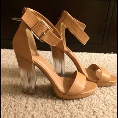 Nude strappy clear chunky heel! These shoes are perfect for any outfit. The clear heel adds a completely unique look! Definite show stopper. Heel height is 4 in. SIZE ON SHOE SAYS 6 BUT FITS LIKE 7!!! Shoes Heels