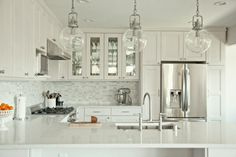 Digging the modern but still homey look of this remodeled kitchen