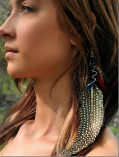 I've always loved Native American inspired fashion. Which includes hair feathers.