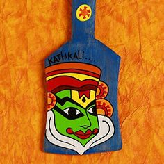 A Krazy Mug: Hand painted Key Holder - Kathakali Blue This is a wooden spatula which is hand painted with the image of Kathakali face. Kathakali is a famous dance form in Indian south region. The background color is Hand Painted in such a way that the wooden grains are seen very clearly which… Shop Now :- http://amzn.to/20AwE7U #handcrafted #handpainted #homedecor #homeimprovement #kathakali #Blue #Keyholder