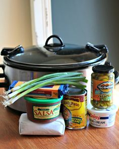 Slow Cooker 7-Layer Bean Dip 15-oz can refried beans 1 # ground beef- cooked, crumbled, drained & seasoned w/salt & pepper 1 c sour cream 1 c salsa 8-oz block cheddar cheese, shredded 1/2 c jarred jalapeno slices 1/4 c green onions (add when done) In oval slow cooker spread refried beans on bottom. Then layer next items, not adding the green onion until the end.  Cover, cook on HIGH 1.5 hrs. If salsa has caused some liquid on the top, blot with paper towel. Serve with tortilla chips and…