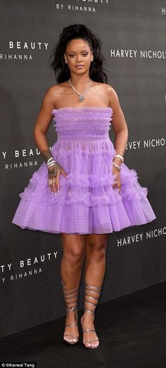 Pretty in purple: She always manages to turn heads with her glamorous ensembles. And Rihan...