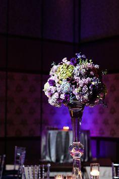 Dramatic and elegant purple floral reception centerpiece at a Disneyland wedding