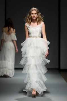 French lace, vintage inspired wedding gown for the modern bohemian bride - Brynn - featured at Riga Fashion Week