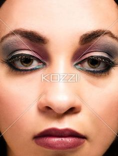 portrait of a beautiful young woman wearing makeup. - Close-up portrait of a beautiful young woman wearing makeup, Model: Taylor Chmiel MUA: Irene Prowell
