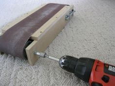 Drill-Powered Belt Sander - Homemade drill-powered belt sander constructed from wood, MDF, PVC, washers, nuts, and bolts.