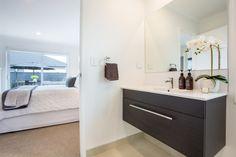 Dark ensuite vanity off the master bedroom.   #ourstories #clientreferences #vanity #ensuite #bathroom #newhome #house #generationhomesnz