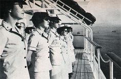 AT SEA—Navy nurses stand formation as USS Repose enters Subic Bay. My father served on this ship in the Korean War.