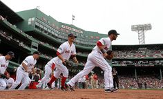 BOSTON, MA - APRIL 15: Dustin Pedroia of the Boston Red Sox leads his team onto the field against Tampa Bay Rays at Fenway Park April 15, 2012 in Boston, Massachusetts. Both teams wore the number 42 in honor of Jackie Robinson Day. (Photo by Jim Rogash/Getty Images)