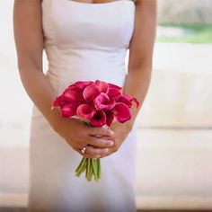 Brides: Elegant Hot Pink Calla Lily Bouquet. Katie's simple bouquet of blush mini calla lilies was tied with a hot-pink ribbon.