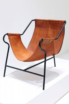 leather sling Chair - funky, fun and simple.  Love this as an accent chair in a small space.